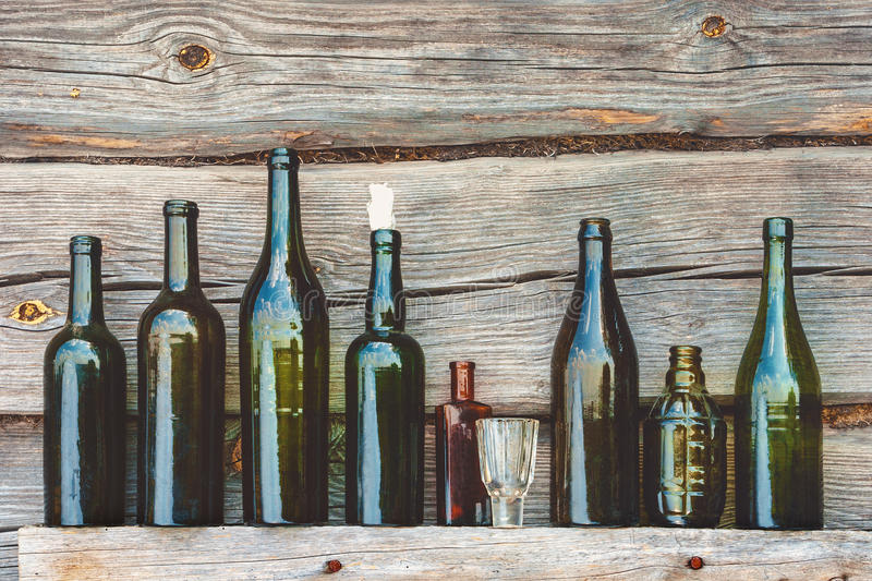 Old bottle and glass royalty free stock image