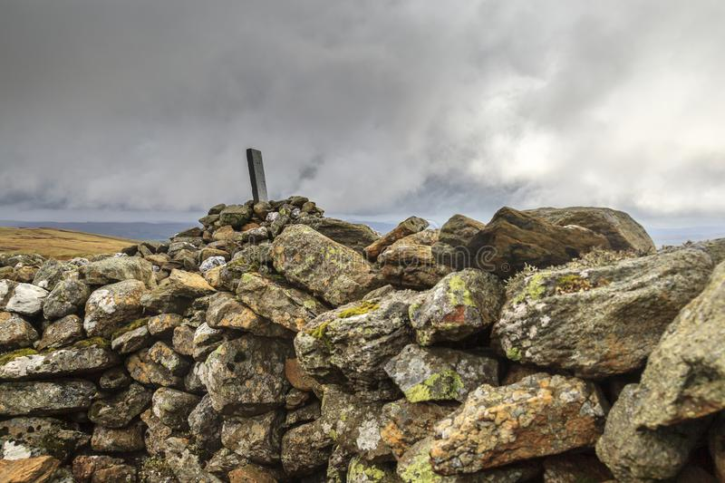 Old Boundary Stone. An old Boundary Stone on carnedd Y Filiast rests on a Cairn, Snowdonia National Park stock photo