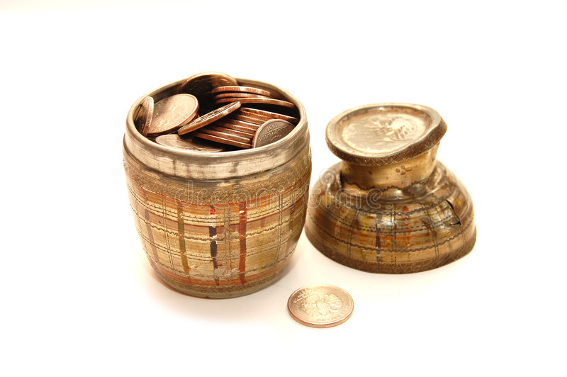 Old bowl filled with coins royalty free stock image