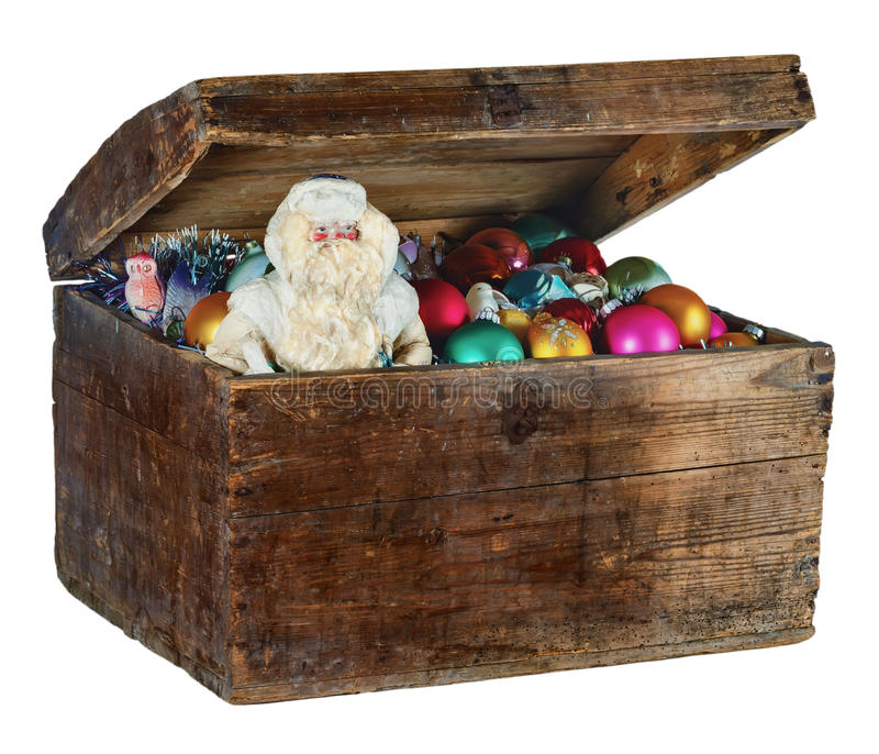 Old box with Christmas decorations and Santa Claus stock images