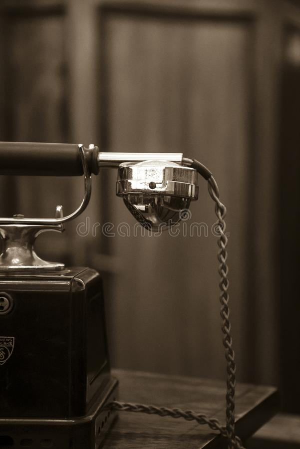 Old telephone receiver royalty free stock photo
