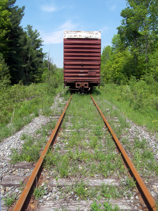 Old Boxcar on Tracks. The end of a boxcar on a rusted portion of track royalty free stock photo