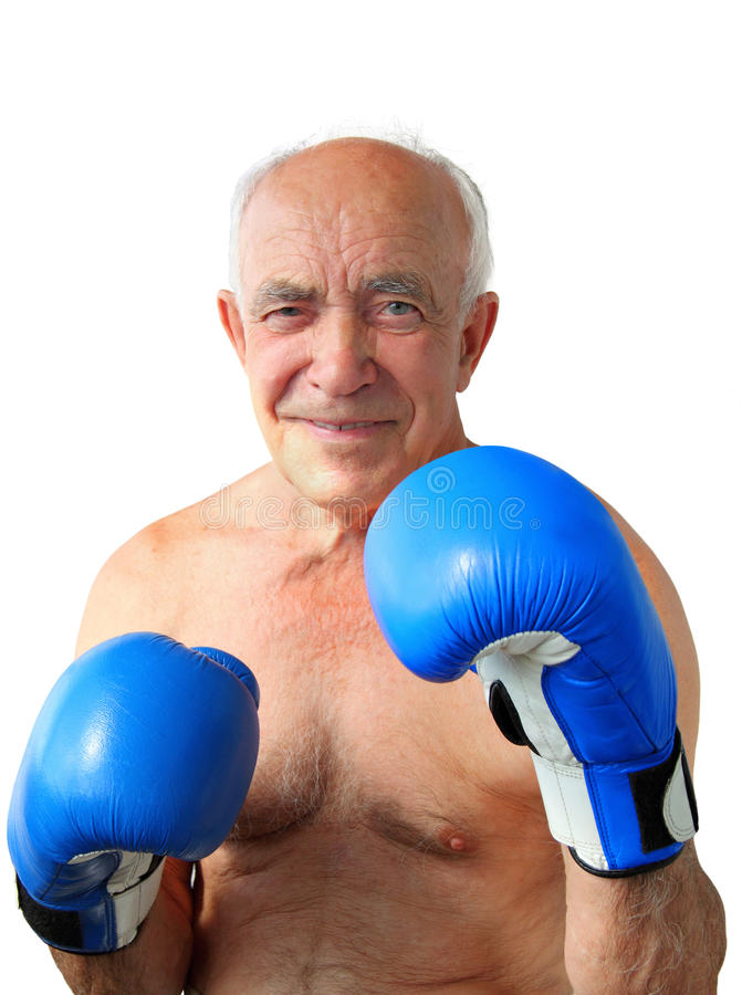 Senior Boxer. Portrait of an old smiling boxer with boxing blue mittens isolated on a white background royalty free stock image