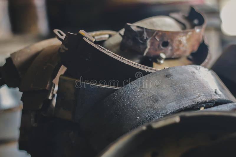 Old brake pads that have been used in the car industry stock photo
