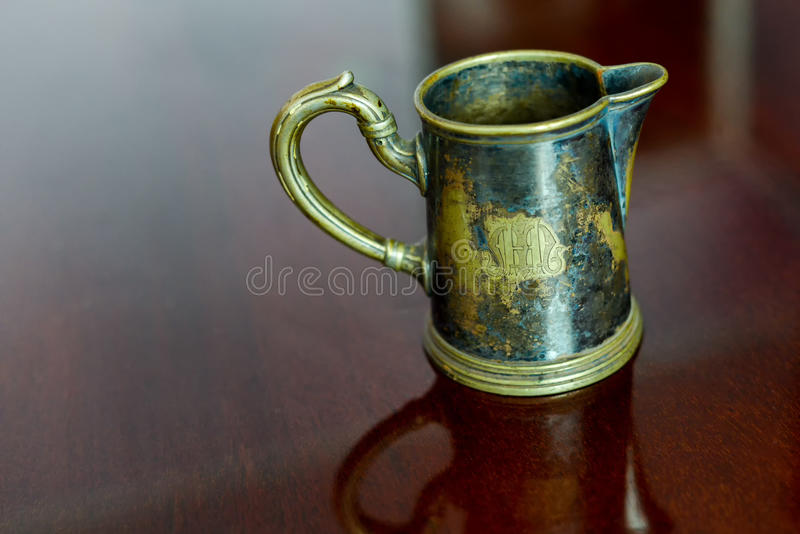 Old brass cup royalty free stock photography