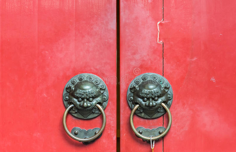 Old brass knocker with lion head royalty free stock photography