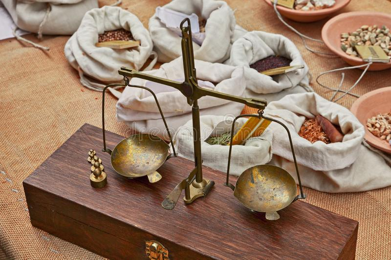 Old brass scales to weigh herbs and spices in old grocery royalty free stock images