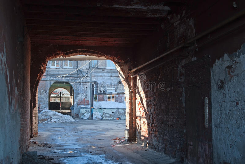 Old breezeway. An old neglected breezeway in brick building stock photo