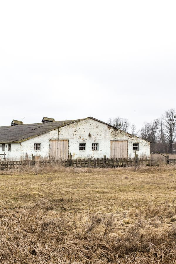 Old brick barns in the field. Old barns. Old brick barns in the field royalty free stock image