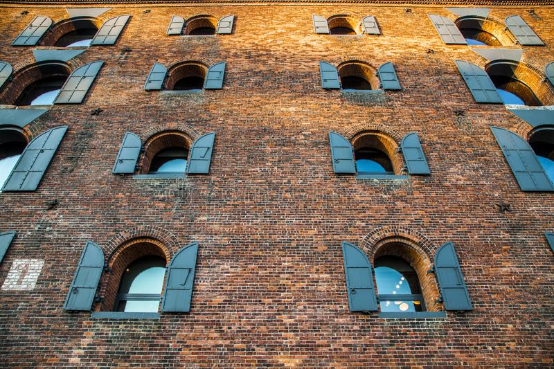 Old brick building in Dumbo, Brooklyn, New York City. Old brick building with windows in Dumbo neighborhood, New York City, USA during daytime stock image