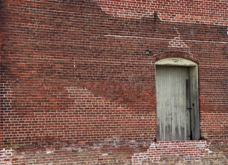 Old Brick Building Is Elegant With Peeling Paint on Door royalty free stock photos
