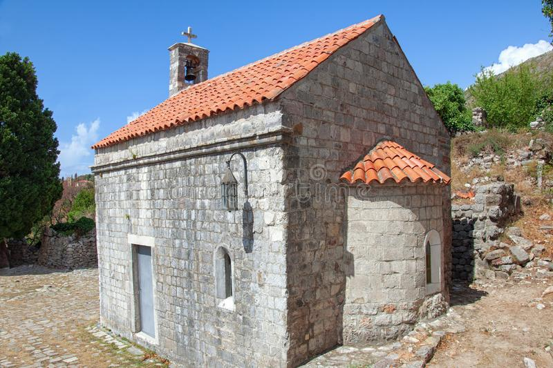 Old brick chapel in the Old Bar fortress, Montenegro. Ancient building with a roof of red tiles. stock photo