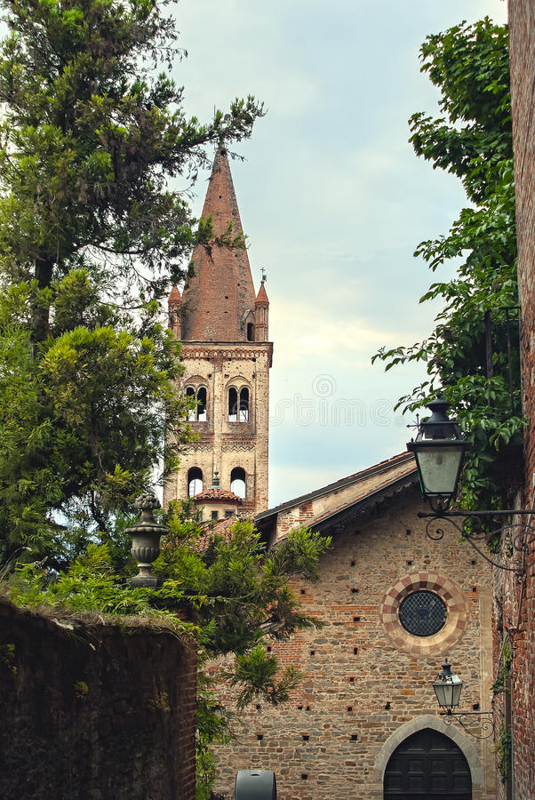 Old brick church. In the ancient city of Saluzzo, northern Italy stock photography