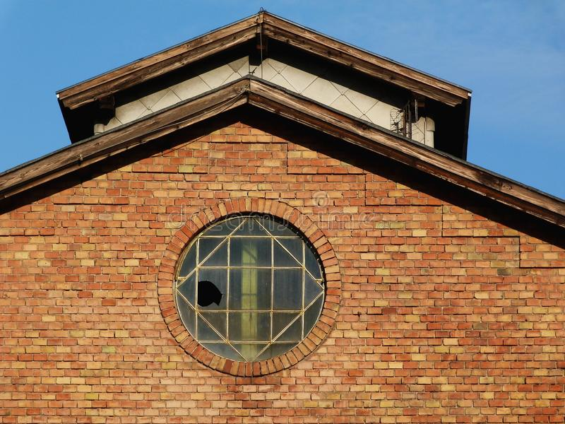 Old brick factory building with broken window royalty free stock photography