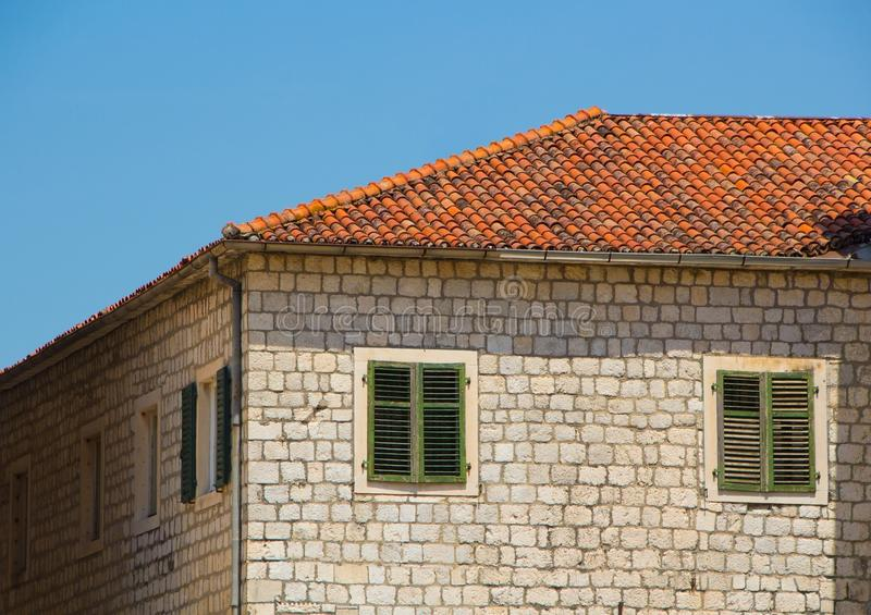Old brick house with a tiled roof. The old town of Kotor, Montenegro. Old brick house with a tiled roof royalty free stock photos