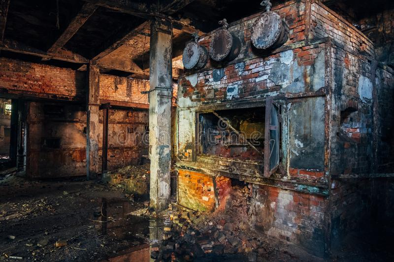 Old brick industrial stove in abandoned boiler room in factory royalty free stock images