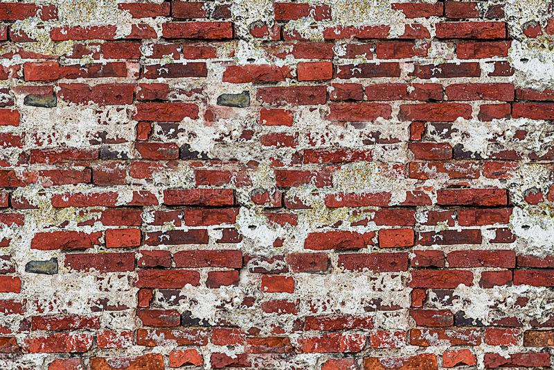 Old brick masonry with white gray stucco chopped chapped weather stock image