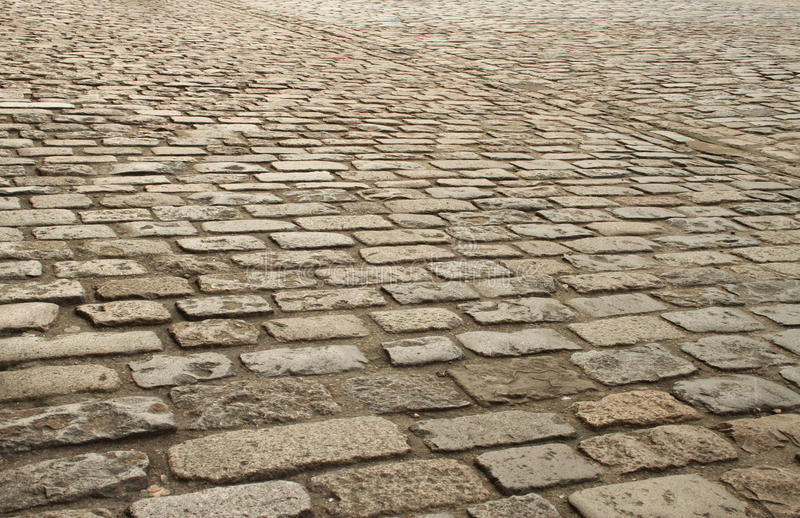 Old brick paving. Outdoors showing texture and detail landscape orientation with copy space stock images
