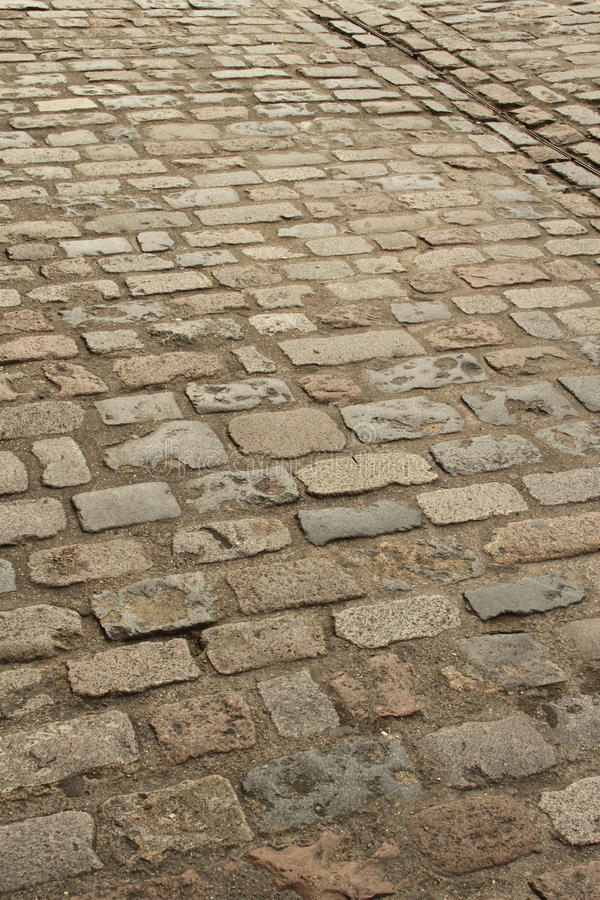 Old brick paving portrait. Old brick paving outdoors showing texture and detail portrait orientation with copy space stock photos