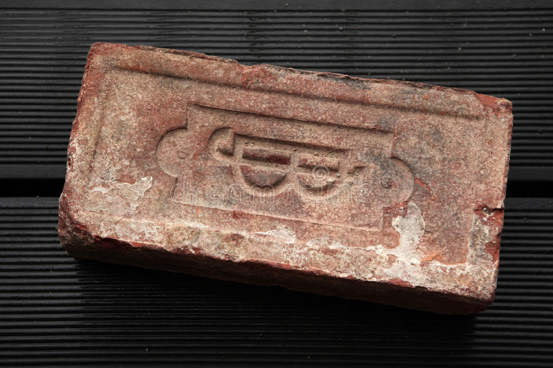 Old brick produced in the Austro-Hungarian Empire. Monogram J.B. sealed on an old brick produced in the 19th century in the Austro-Hungarian Empire stock photos