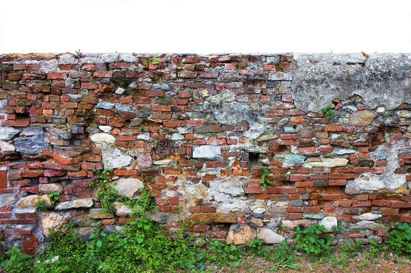 Old brick and stone italian wall built in the 1800s to separate the ownership of farmland royalty free stock photo
