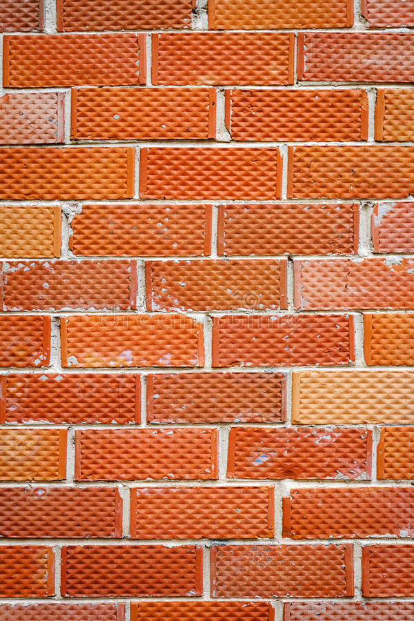 Old brick wall. Background of old red and dotted brick wall texture, abstract vertical architecture wallpaper royalty free stock photos