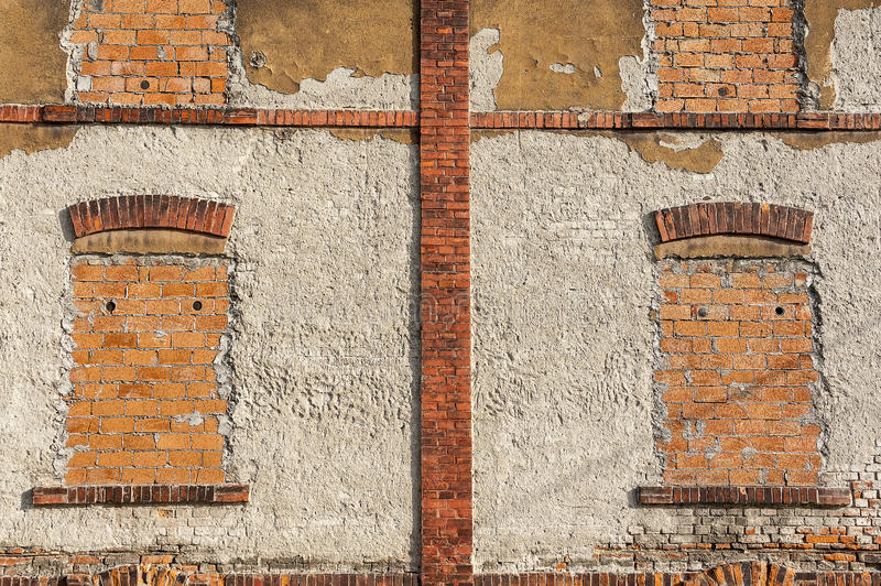 Old brick wall with blinded windows. Old aged two floor red brick wall - facade of a building with blinded windows stock images