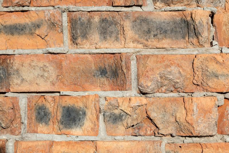 Old brick wall of brown color. Texture grunge background. Close up stock photos