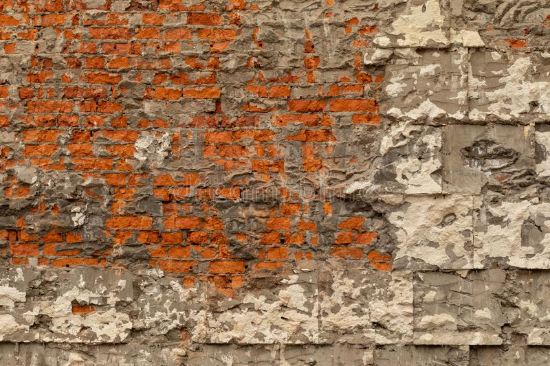 Old brick wall with destroyed plaster and concrete. Dismantling the building stock photos