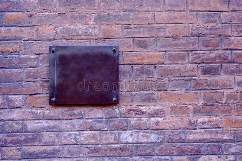 Old brick wall and empty metal plate royalty free stock photos