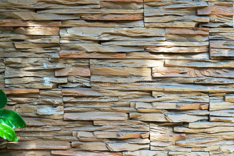 Old brick wall from a flat stone and green grass in the foreground. royalty free stock image
