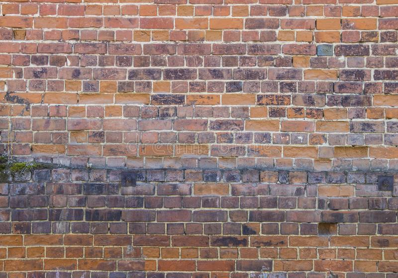Dark Red Brick wall background and texture.Old Brick wall. Grunge red vintage background. stock photography