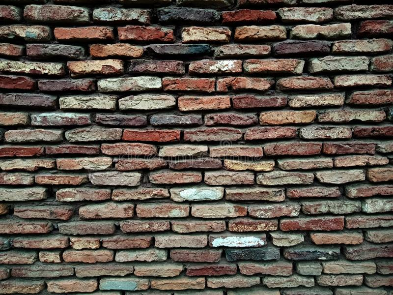 Old brick wall with lots of texture and colors. stock image