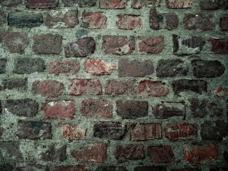 Old brick wall with lots of texture and colors. royalty free stock photo