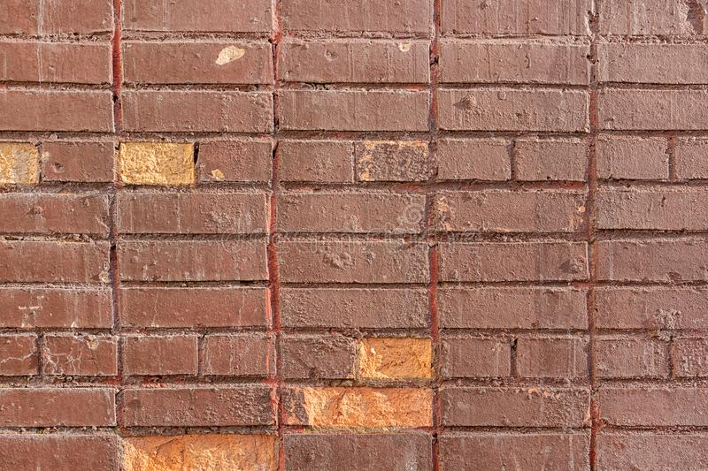 Old brick wall is painted with brown paint. Blank background with brickwork texture. stock photo