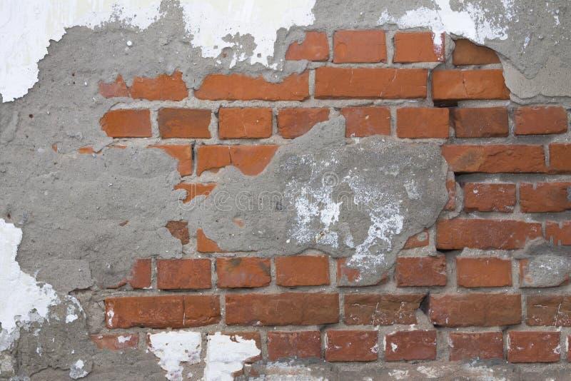 Old brick wall, plaster royalty free stock photos
