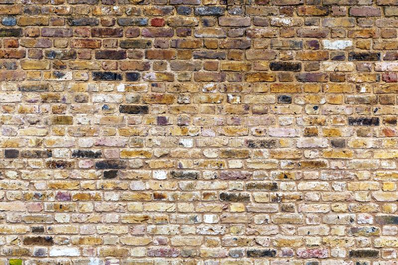 An old, weathered, brown brick wall. stock photos