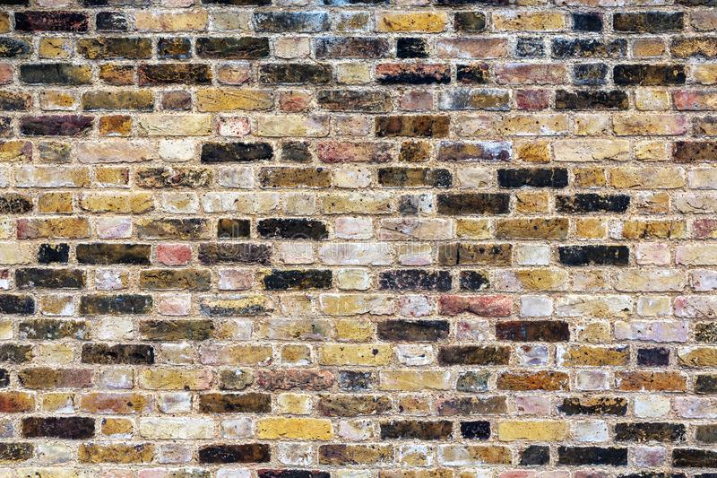 A old, weathered, patterned, brick wall. stock image