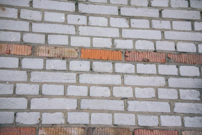 Old brick wall surface.Texture, background.Roughly textured brick walls stock photo