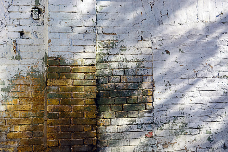 Old brick wall texture background with worn off paint royalty free stock image