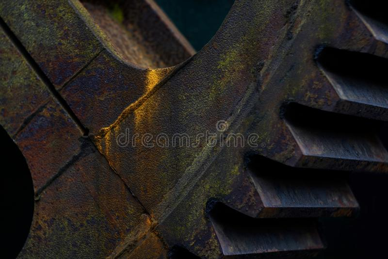 Old Rusty Cog. A moody but detailed image of a large rusty old cog from a disused mining equipment stock images