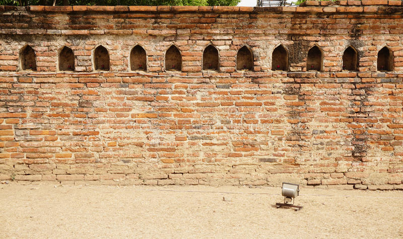 Old brick wall with traditional niche. Old red brick wall with traditional niche in Thailand royalty free stock photos