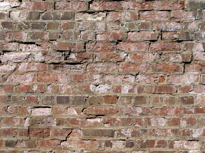 Old Brick Wall. A weathered old red brick wall slightly posterized for an added rugged effect royalty free stock photos
