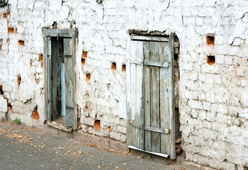 Old brick wall and windows. With wooden shutters stock photo