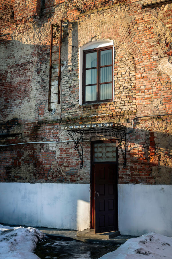 Free Old Brick Wall With A Door, A Window And Stairs Stock Images - 49666694