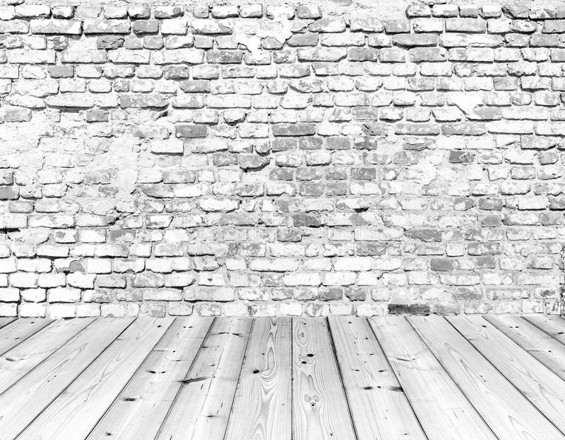 Old brick wall on wood floor royalty free stock photos