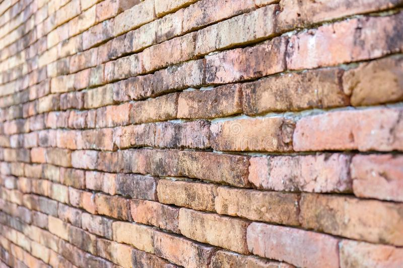 Diagonal corner of old red brick wall, wallpaper texture background royalty free stock image