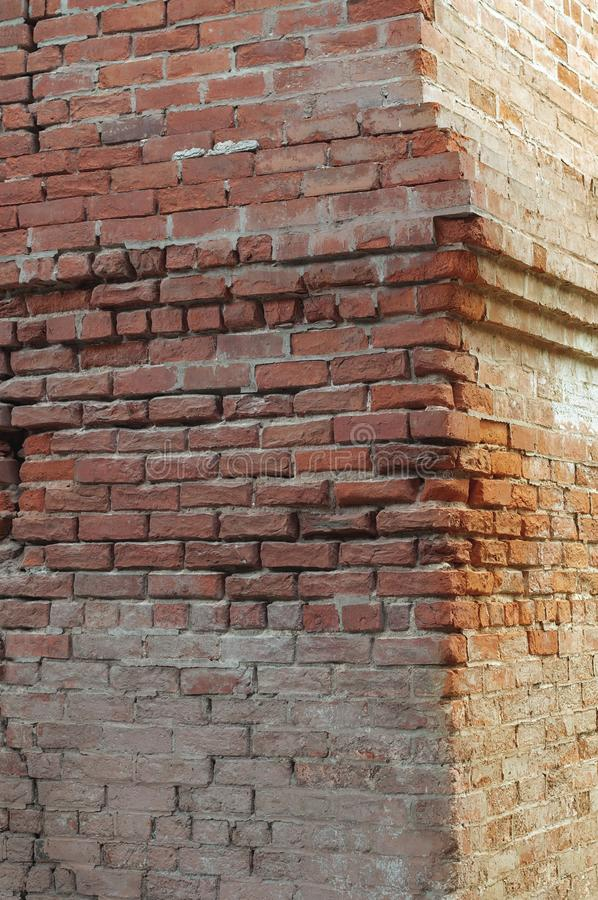 Old brickwork cracks and fissures in warm sunlight. Old brickwork cracks and fissures in warm sunlight for background royalty free stock photo