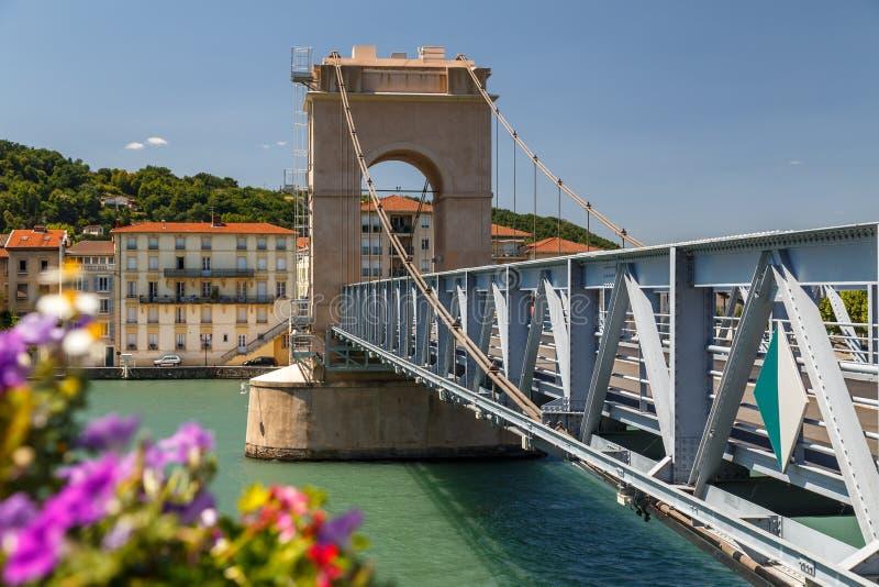 Old bridge across Rhone in Vienne town stock images