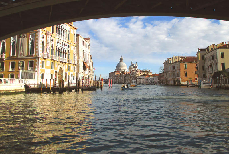 The old bridge against the Venetian style vintage buildings, Italy royalty free stock images